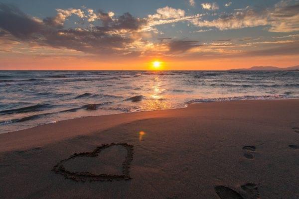 sunset-beach-w-heart-in-sand-e1509709838951